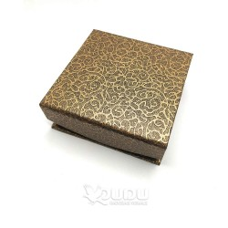 Brownish mottled box with magnet