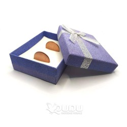 Gray-purple box with a silver bow